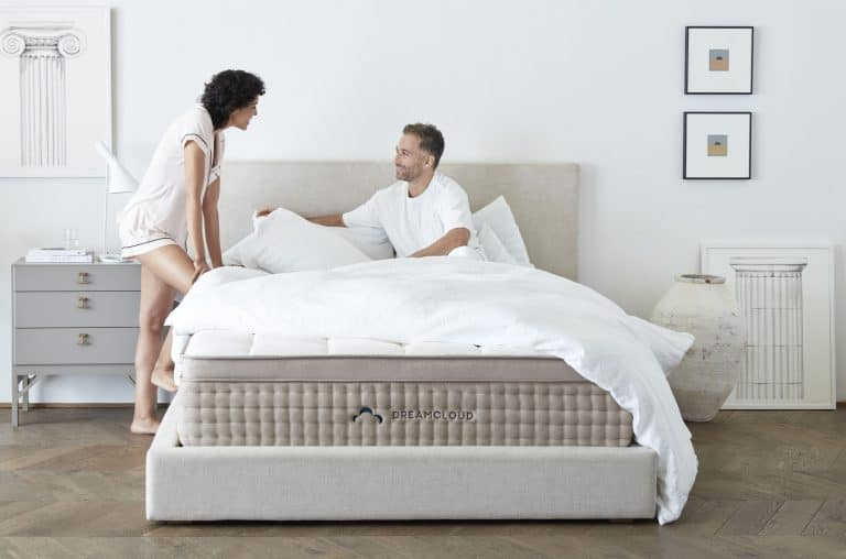 A Couple sleeping on a Dreamcloud Mattress