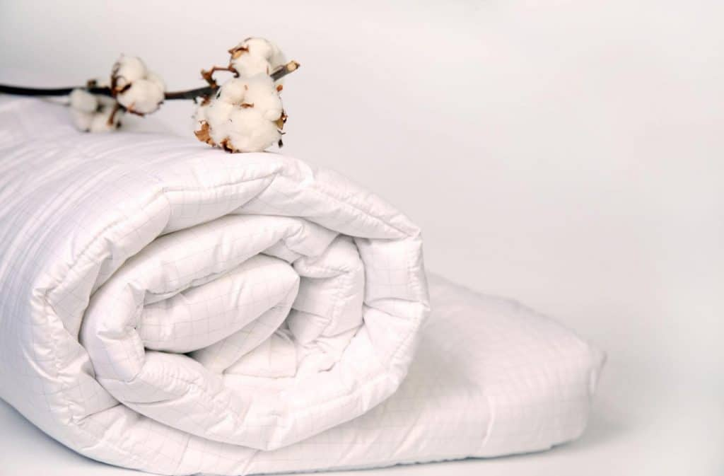 Cotton on a white colored duvet
