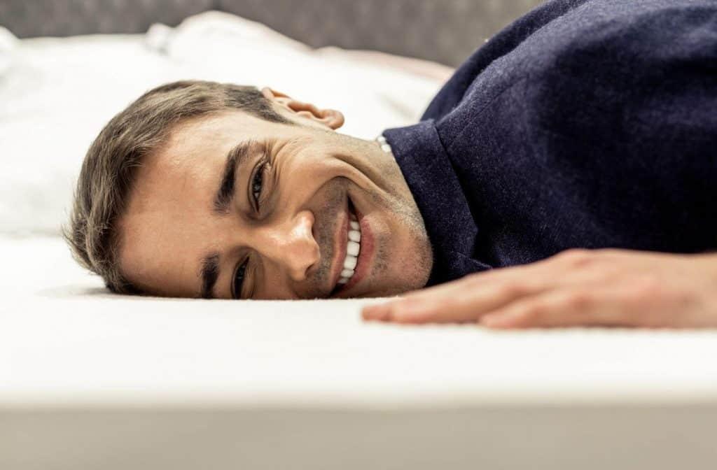 A Man Sleeping on a Mattress