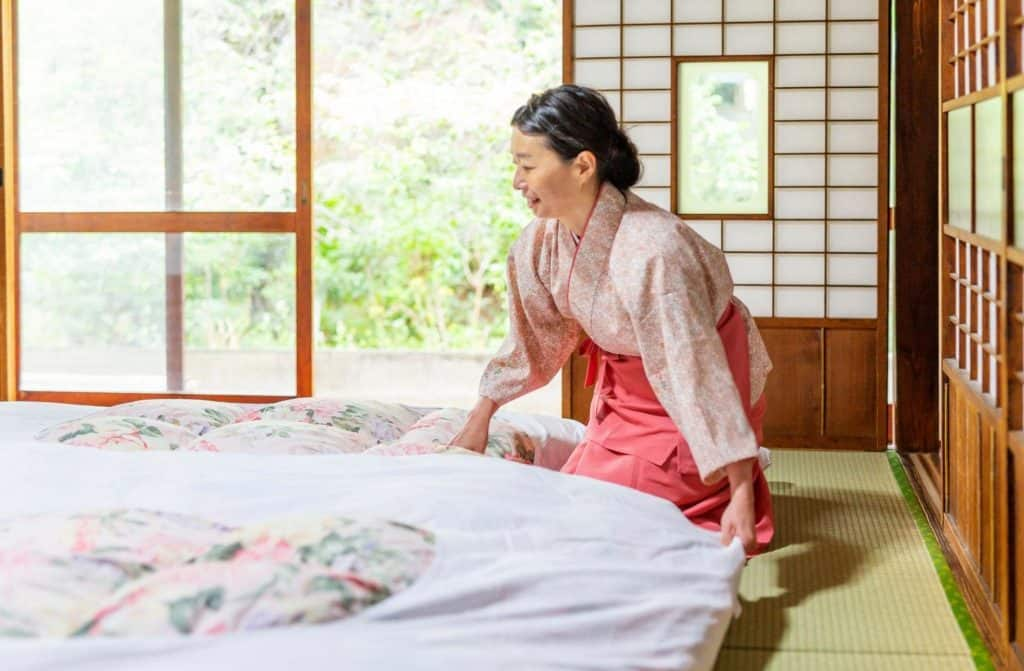 Japanese Woman Making a Traditional Futon Bed