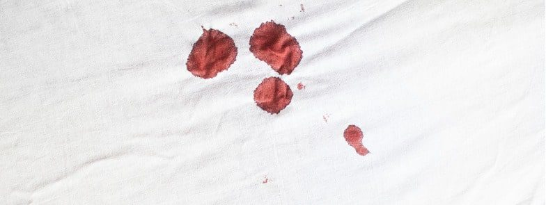 Blood stains on white sheet