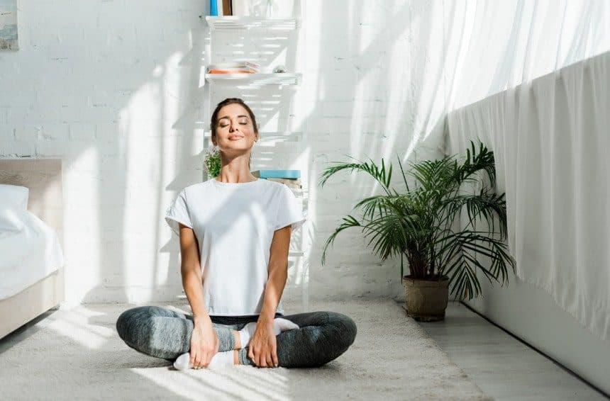 a girl doing the meditation for the better sleep
